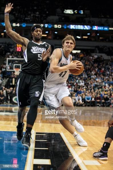 Andrei Kirilenko of the Minnesota Timberwolves drives to the basket against John Salmons of the Sacramento Kings during the season opening game on...