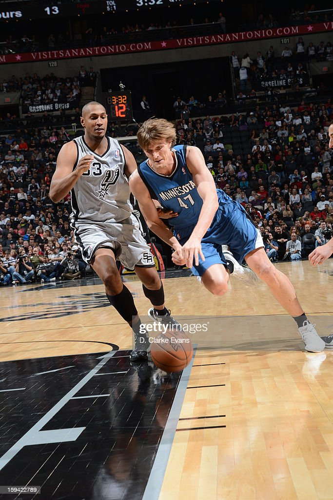 Andrei Kirilenko #47 of the Minnesota Timberwolves drives to the basket against Boris Diaw #33 of the San Antonio Spurs on January 13, 2013 at the AT&T Center in San Antonio, Texas.
