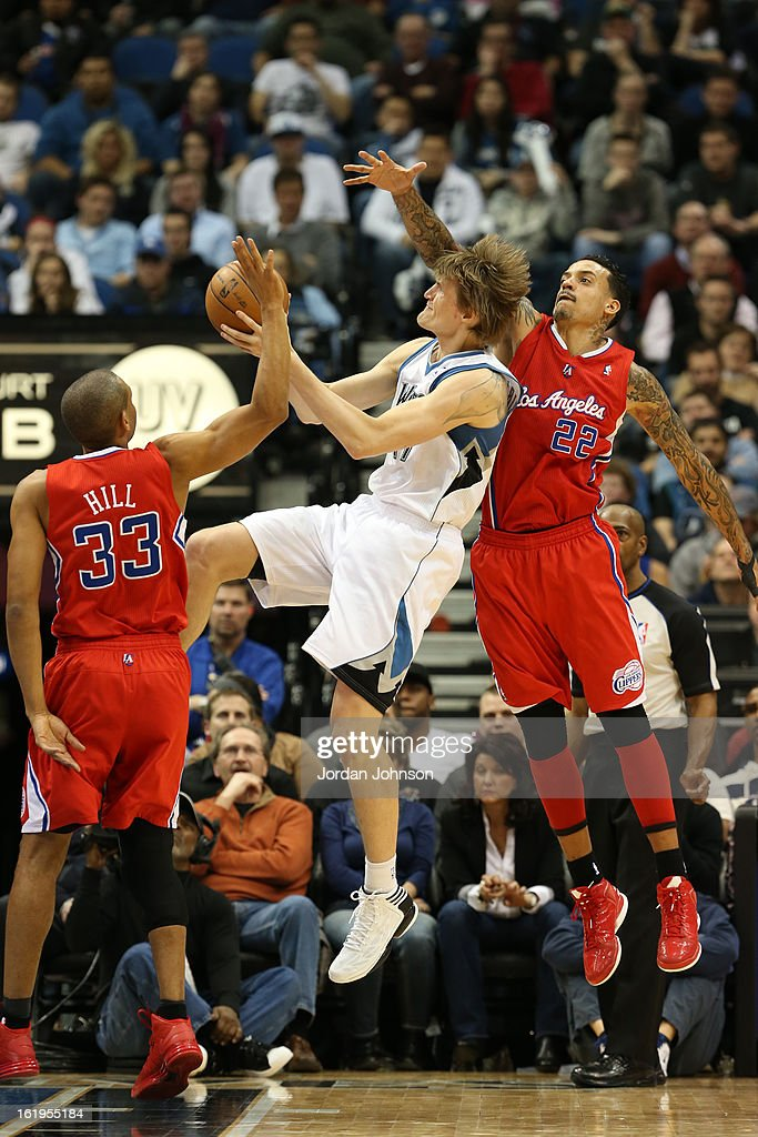 Andrei Kirilenko #47 of the Minnesota Timberwolves drives to the basket around <a gi-track='captionPersonalityLinkClicked' href=/galleries/search?phrase=Matt+Barnes+-+Joueur+de+basketball&family=editorial&specificpeople=202880 ng-click='$event.stopPropagation()'>Matt Barnes</a> #22 of the Los Angeles Clippers on January 17, 2013 at Target Center in Minneapolis, Minnesota.