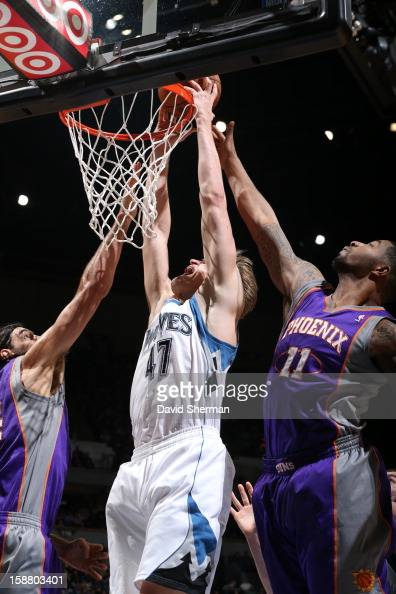 Andrei Kirilenko of the Minnesota Timberwolves dunks the ball against Markieff Morris of the Phoenix Suns during the game between the Minnesota...