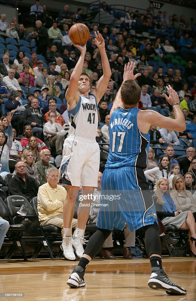 Andrei Kirilenko #47 of the Minnesota Timberwolves goes for a jump shot against Lou Amundson #17 of the Minnesota Timberwolves during the game between the Minnesota Timberwolves and the Orlando Magic on November 7, 2012 at Target Center in Minneapolis, Minnesota.