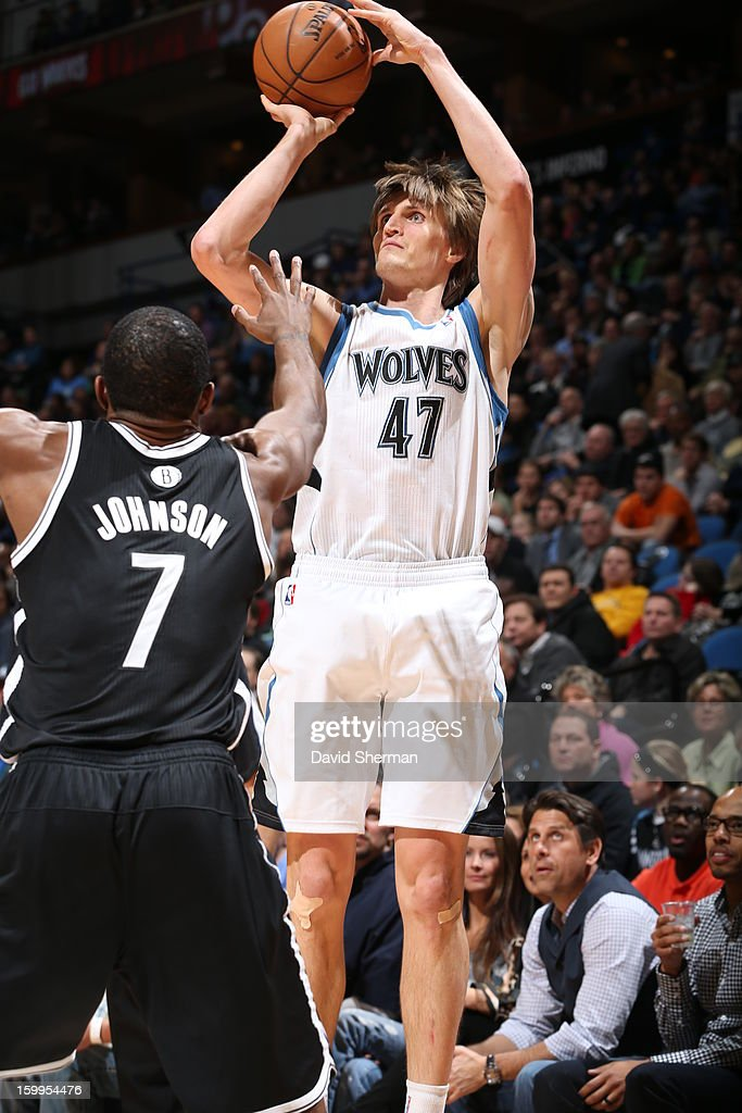 Andrei Kirilenko #47 of the Minnesota Timberwolves goes for a jump shot against Joe Johnson #7 of the Brooklyn Nets during the game between the Minnesota Timberwolves and the Brooklyn Nets on January 23, 2013 at Target Center in Minneapolis, Minnesota.