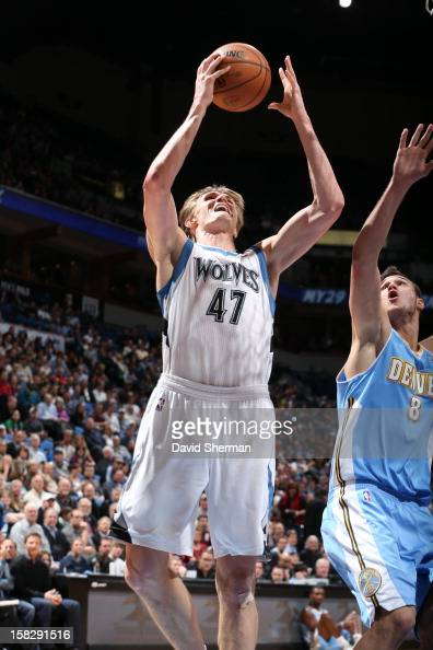 Andrei Kirilenko of the Minnesota Timberwolves goes to the basket against Danilo Gallinari of the Denver Nuggets during the game between the...