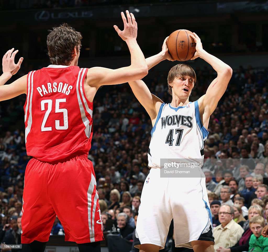 Andrei Kirilenko #47 of the Minnesota Timberwolves looks to pass against Chandler Parsons #25 of the Houston Rockets during the game on January 19, 2013 at Target Center in Minneapolis, Minnesota.