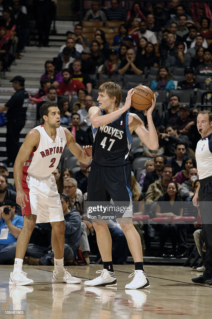 Andrei Kirilenko #47 of the Minnesota Timberwolves looks to pass as Landry Fields #2 Toronto Raptors plays tight defense on him - on November 4, 2012 at the Air Canada Centre in Toronto, Ontario, Canada.