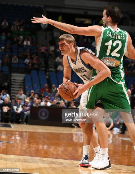 Andrei Kirilenko of the Minnesota Timberwolves looks to pass the ball against Pat Calathes of the Maccabi Haifa on October 16 2012 at Target Center...