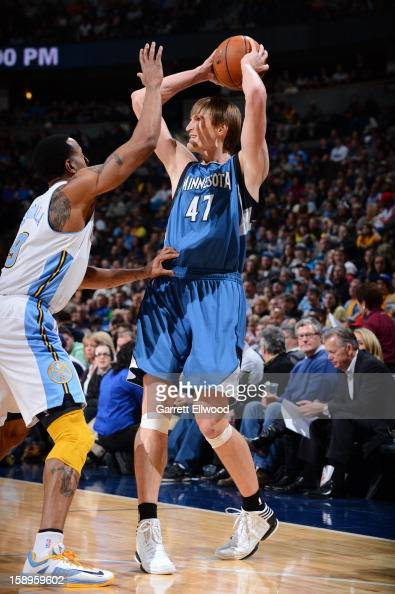Andrei Kirilenko of the Minnesota Timberwolves looks to pass the ball against Andre Iguodala of the Denver Nuggets on January 3 2013 at the Pepsi...