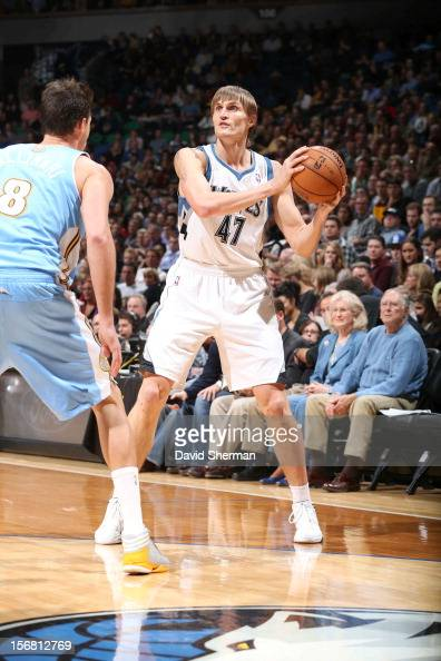 Andrei Kirilenko of the Minnesota Timberwolves protects the ball from Danilo Gallinari of the Denver Nuggets during the game between the Minnesota...