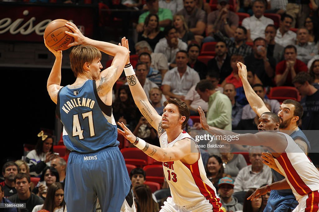 <a gi-track='captionPersonalityLinkClicked' href=/galleries/search?phrase=Andrei+Kirilenko&family=editorial&specificpeople=201909 ng-click='$event.stopPropagation()'>Andrei Kirilenko</a> #47 of the Minnesota Timberwolves protects the ball from <a gi-track='captionPersonalityLinkClicked' href=/galleries/search?phrase=Mike+Miller+-+Basketball+Player&family=editorial&specificpeople=201801 ng-click='$event.stopPropagation()'>Mike Miller</a> #13 of the Miami Heat during a game between the Minnesota Timberwolves and the Miami Heat on December 18, 2012 at American Airlines Arena in Miami, Florida.