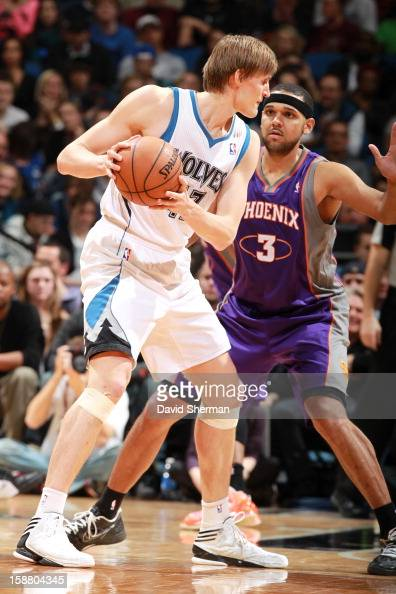 Andrei Kirilenko of the Minnesota Timberwolves protects the ball from Jared Dudley of the Phoenix Suns during the game between the Minnesota...