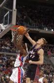 Andrei Kirilenko of the Utah Jazz blocks Richard Hamilton of the Detroit Pistons December 21 2003 at the Palace of Auburn Hills in Auburn Hills...