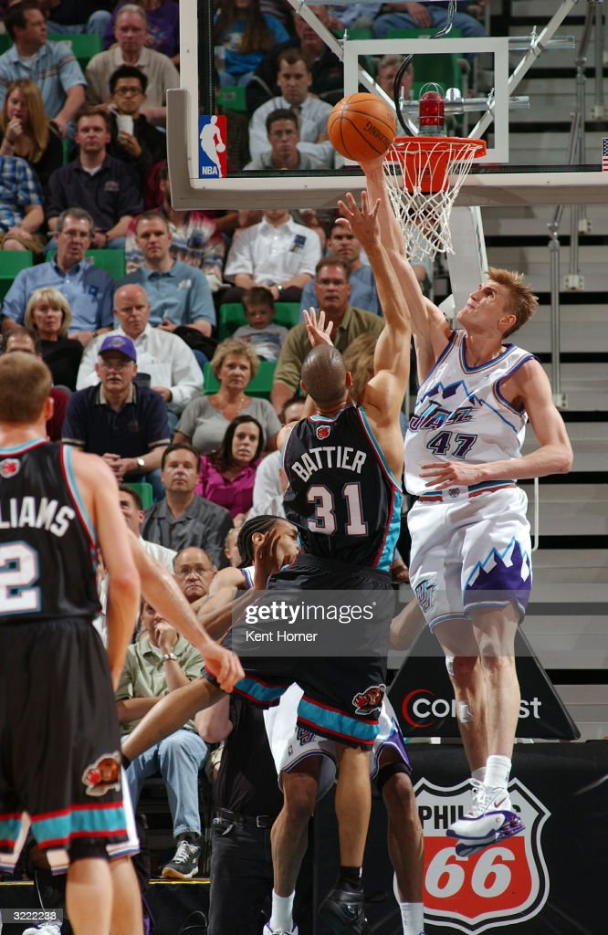 Andrei Kirilenko of the Utah Jazz blocks the shot of Shane Battier of the Memphis Grizzlies on April 5 2004 at the Delta Center in Salt Lake City...