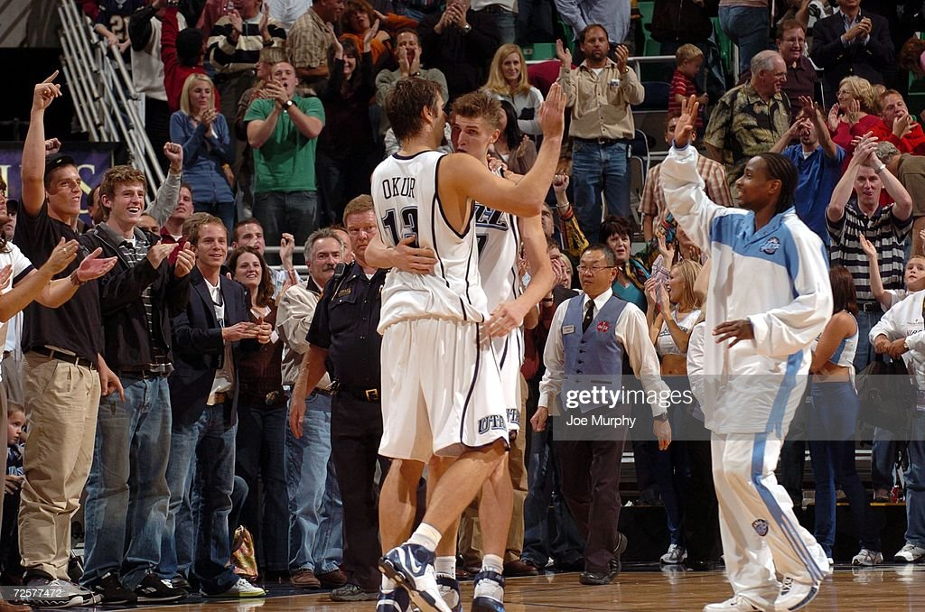 Andrei Kirilenko #47 of the Utah Jazz celebrates with his teammate Mehmet Okur #13 during the game against the Detroit Pistons on November 6, 2006 at the Delta Center in Salt Lake City, Utah. The Jazz won 103-101.