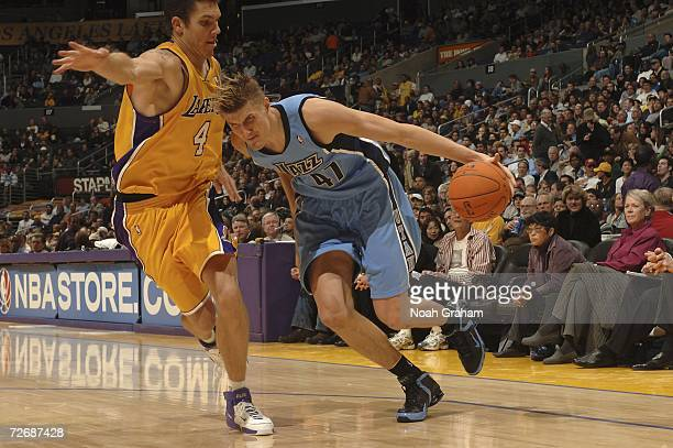 Andrei Kirilenko of the Utah Jazz drives to the hoop against Luke Walton of the Los Angeles Lakers on November 30 2006 at Staples Center in Los...