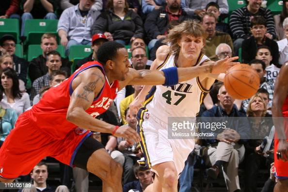 Andrei Kirilenko of the Utah Jazz goes for the loose ball against Andre Iguodala of the Philadelphia 76ers at EnergySolutions Arena on March 14 2011...
