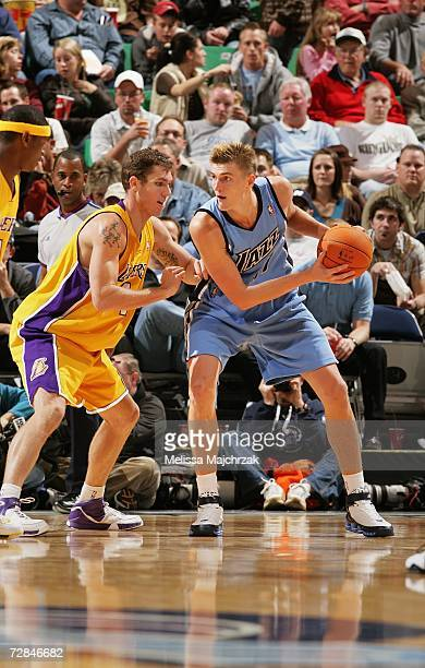 Andrei Kirilenko of the Utah Jazz looks to move the ball against Luke Walton of the Los Angeles Lakers on November 24 2006 at EnergySolutions Arena...