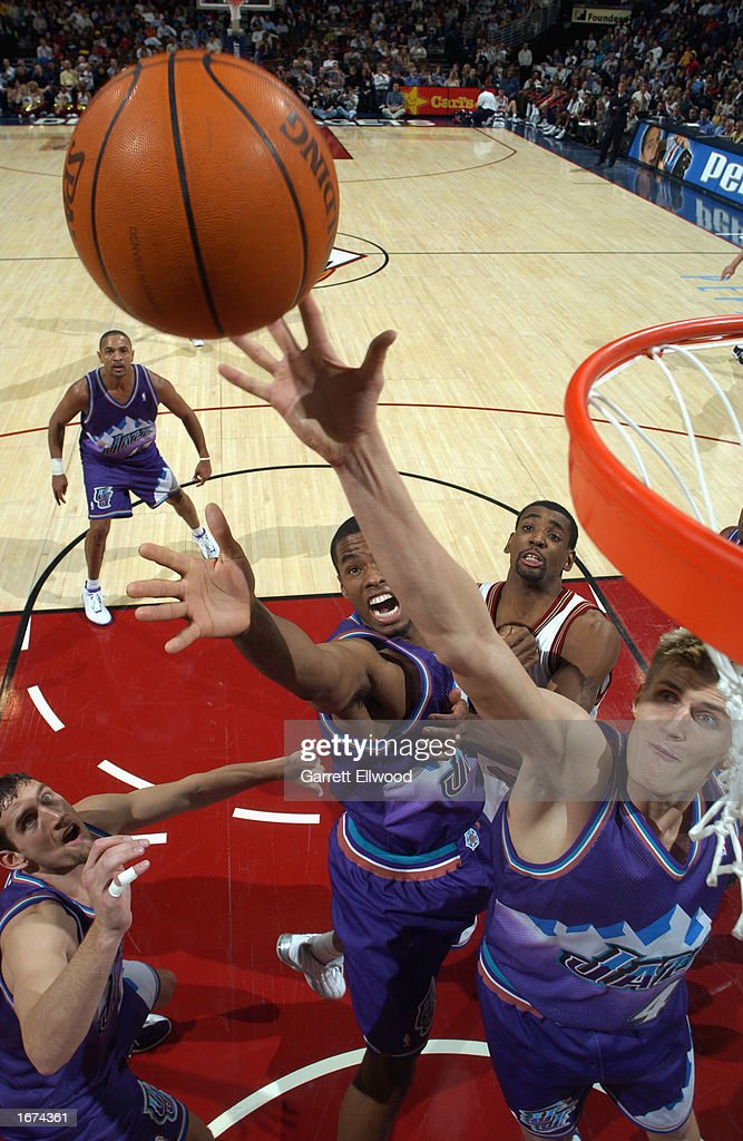 Andrei Kirilenko #47 of the Utah Jazz reaches for the ball during the game against the Denver Nuggets at Pepsi Center on November 20, 2002 in Denver, Colorado. The Nuggets won 84-73.