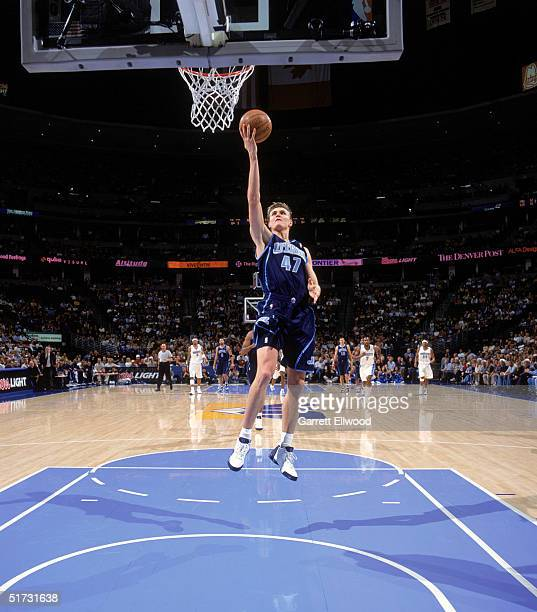Andrei Kirilenko of the Utah Jazz shoots a layup against the Denver Nuggets during the game at the Pepsi Center on November 6 2004 in Denver Colorado...