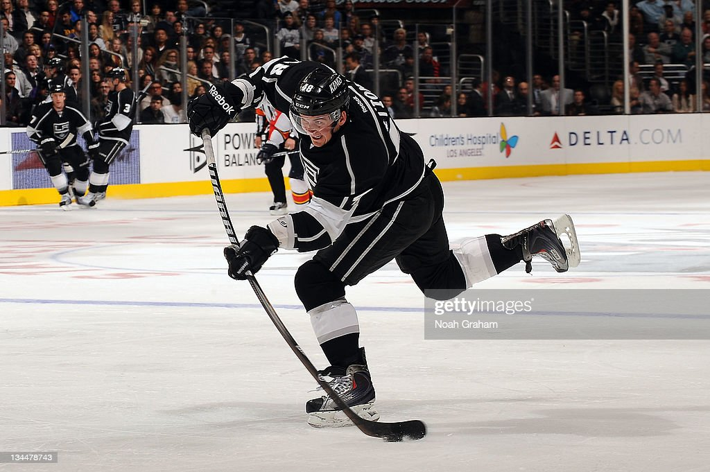 Andrei Loktionov #48 of the Los Angeles Kings shoots the puck against the Florida Panthers at Staples Center on December 1, 2011 in Los Angeles, California.