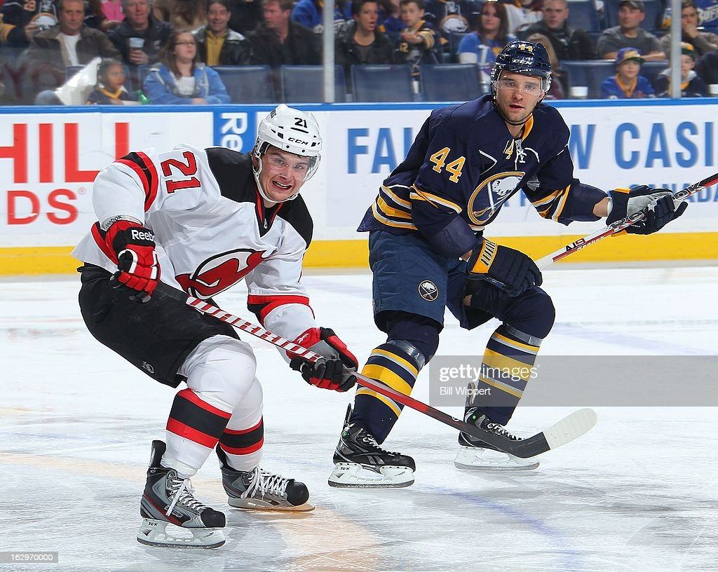 Andrei Loktionov #21 of the New Jersey Devils and Andrej Sekera #44 of the Buffalo Sabres follow the puck on March 2, 2013 at the First Niagara Center in Buffalo, New York.