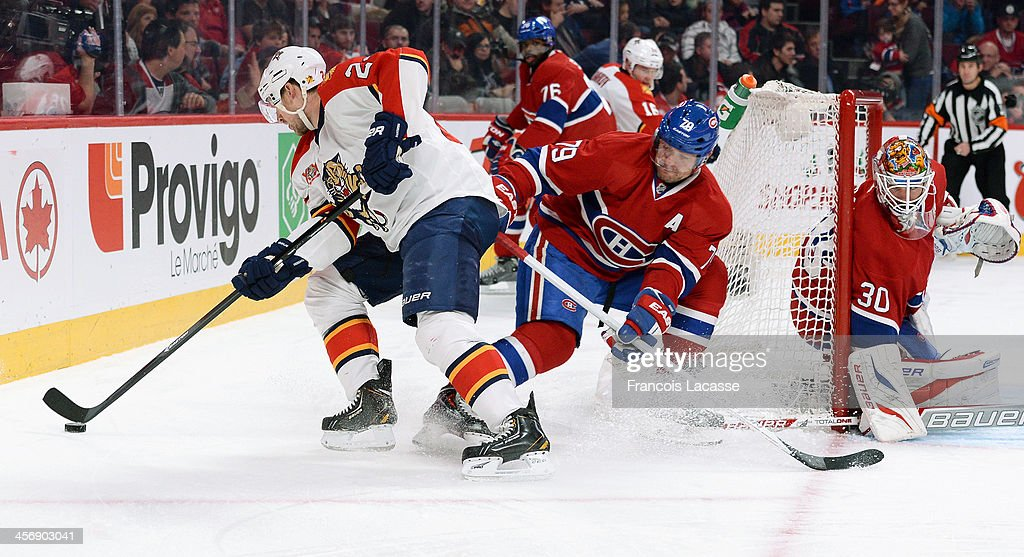 <a gi-track='captionPersonalityLinkClicked' href=/galleries/search?phrase=Andrei+Markov&family=editorial&specificpeople=204528 ng-click='$event.stopPropagation()'>Andrei Markov</a> #79 and <a gi-track='captionPersonalityLinkClicked' href=/galleries/search?phrase=Peter+Budaj&family=editorial&specificpeople=228123 ng-click='$event.stopPropagation()'>Peter Budaj</a> #30 of the Montreal Canadiens, defend the goal against <a gi-track='captionPersonalityLinkClicked' href=/galleries/search?phrase=Brad+Boyes&family=editorial&specificpeople=275014 ng-click='$event.stopPropagation()'>Brad Boyes</a> #24 of the Florida Panthers during the NHL game on December 15, 2013 at the Bell Centre in Montreal, Quebec, Canada.