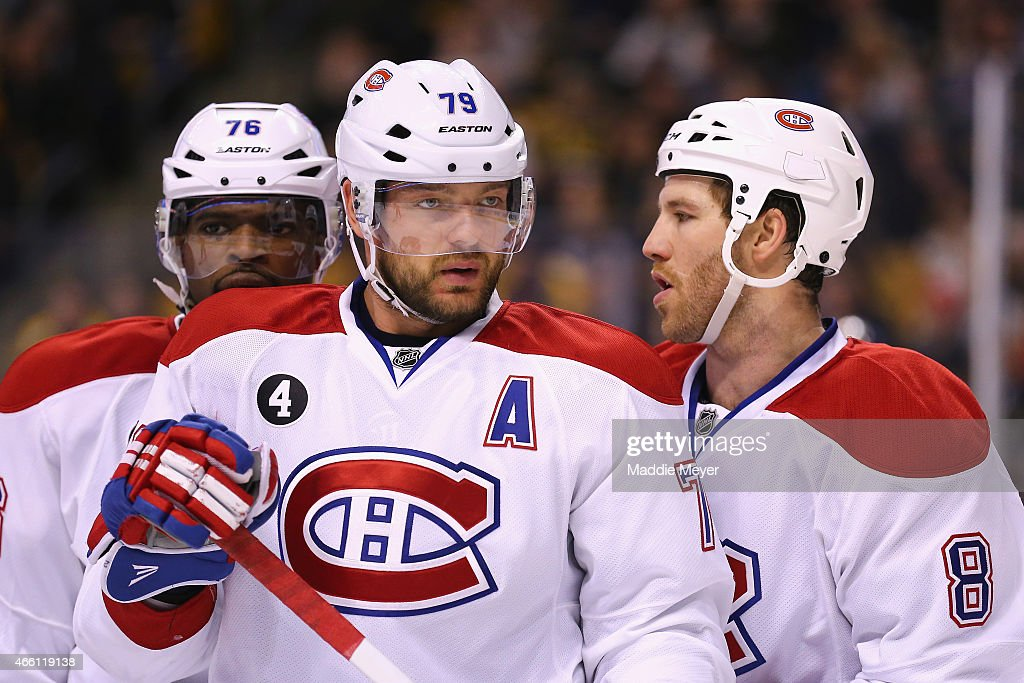 Andrei Markov #79, Brandon Prust #8 and P.K. Subban #76 of the Montreal Canadiens talk together during the first period against the Boston Bruins at TD Garden on February 8, 2015 in Boston, Massachusetts.