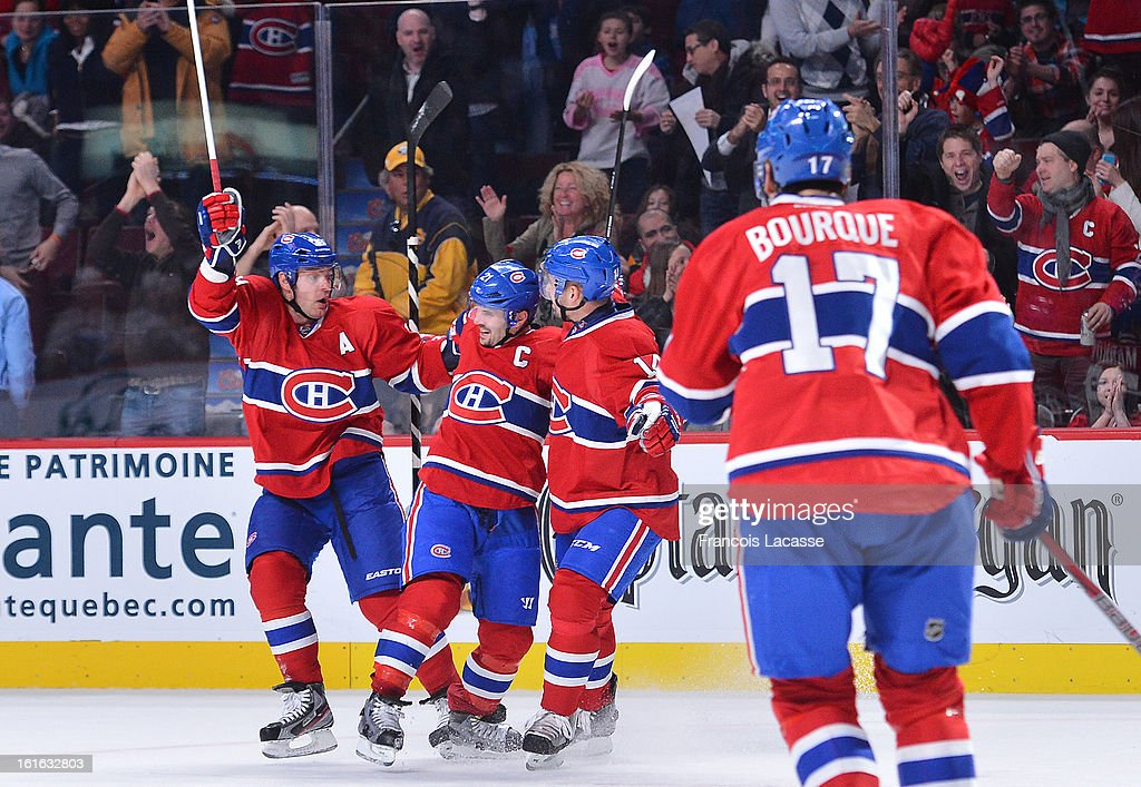 Andrei Markov #79 Brian Gionta #21 and Tomas Plekanek #14 of the Montreal Canadiens celebrate a goal during the first period of NHL game against the Buffalo Sabres on February 2, 2013 at the Bell Centre in Montreal, Quebec, Canada.