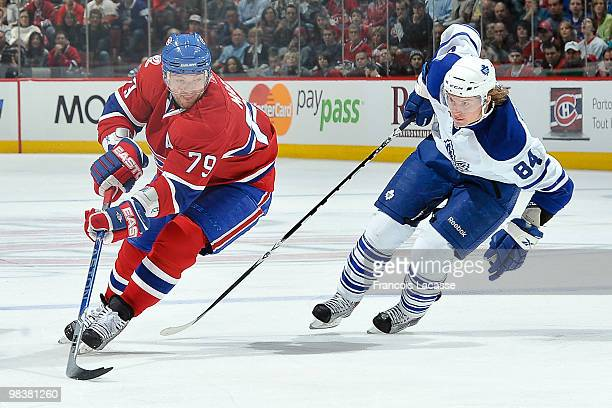Andrei Markov of Montreal Canadiens skates with the puck in front of Mikhail Grabovski of the Toronto Maple Leafs during the NHL game on April 10...
