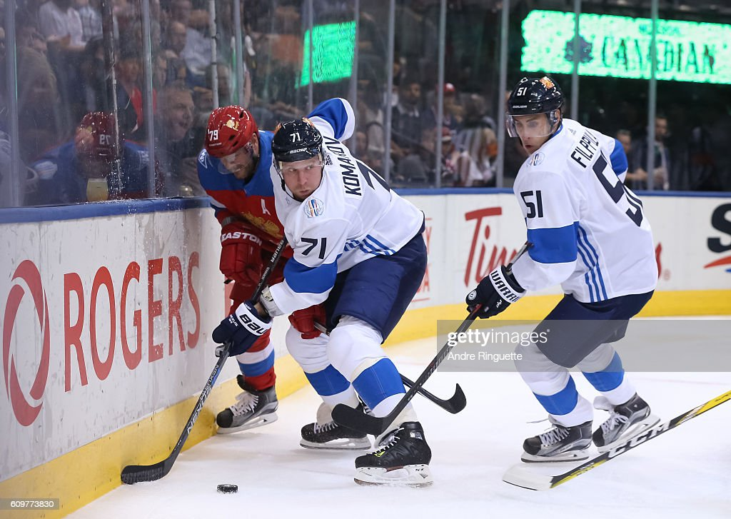Andrei Markov #79 of Team Russia battles for the puck with Leo Komarov #71 and Valtteri Filppula #51 of Team Finland during the World Cup of Hockey 2016 at Air Canada Centre on September 22, 2016 in Toronto, Ontario, Canada.