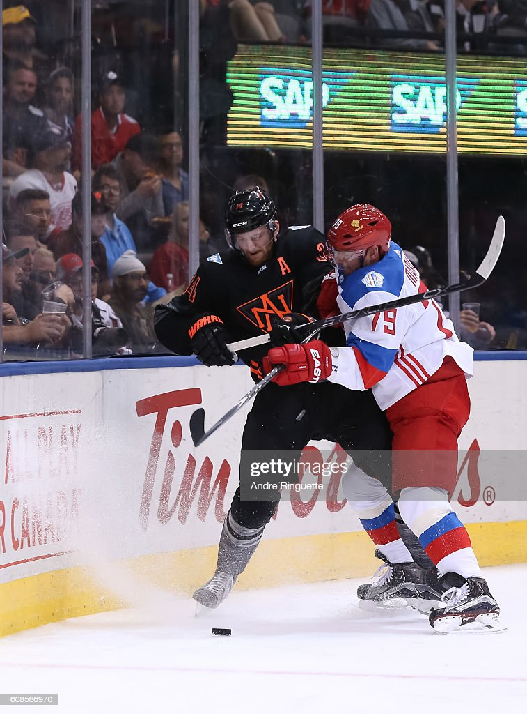 Andrei Markov #79 of Team Russia collides with Sean Couturier #14 of Team North America along the boards during the World Cup of Hockey 2016 at Air Canada Centre on September 19, 2016 in Toronto, Ontario, Canada.