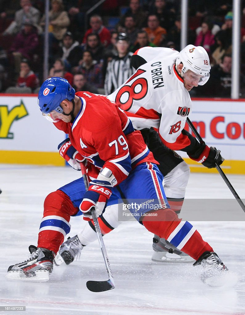 Andrei Markov #79 of the Montreal Canadiens and Jim O'Brien # 18 of the Ottawa Senators battle for a bouncing puck during during the NHL game on February 3, 2013 at the Bell Centre in Montreal, Quebec, Canada.