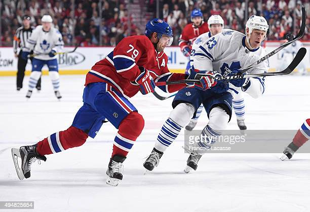Andrei Markov of the Montreal Canadiens and Shawn Matthias of the Toronto Maple Leafs battle for position in the NHL game at the Bell Centre on...