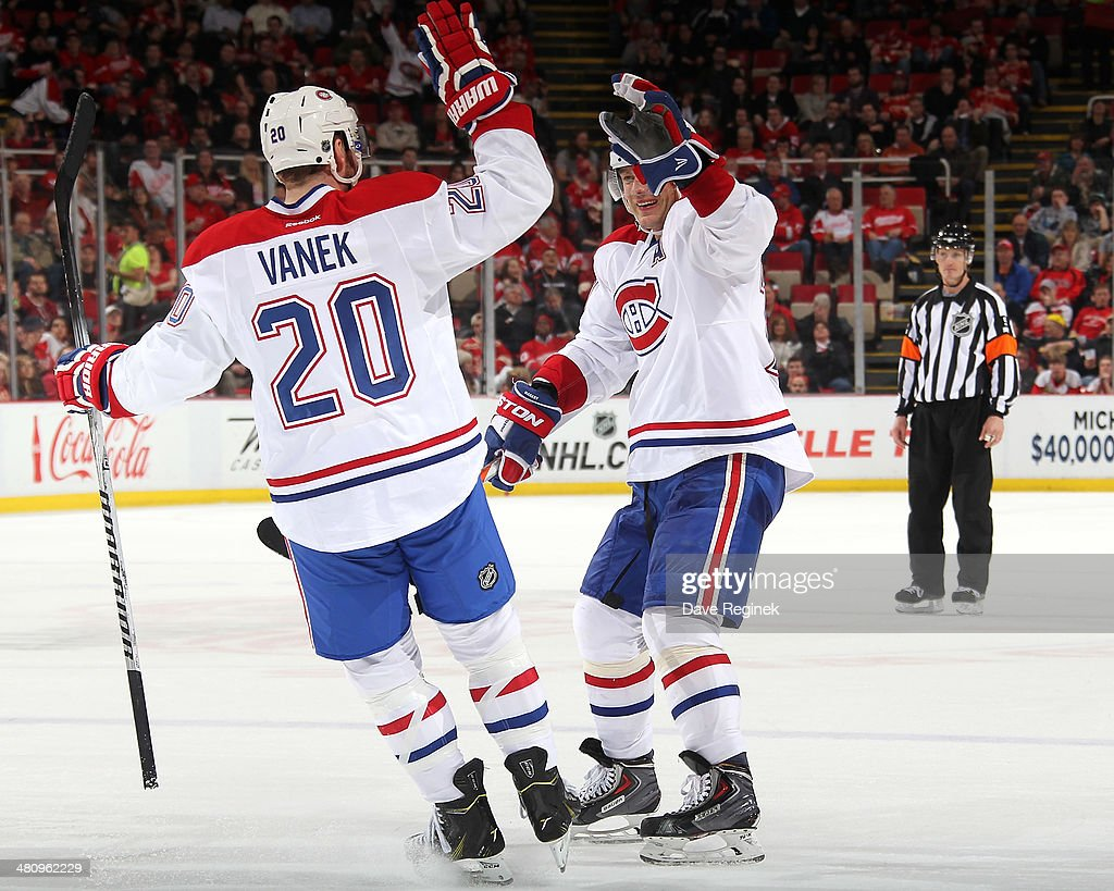 <a gi-track='captionPersonalityLinkClicked' href=/galleries/search?phrase=Andrei+Markov&family=editorial&specificpeople=204528 ng-click='$event.stopPropagation()'>Andrei Markov</a> #79 of the Montreal Canadiens and teammate <a gi-track='captionPersonalityLinkClicked' href=/galleries/search?phrase=Thomas+Vanek&family=editorial&specificpeople=570606 ng-click='$event.stopPropagation()'>Thomas Vanek</a> #20 celebrate after connecting on the game winning goal during an NHL game against the Detroit Red Wings on March 27, 2014 at Joe Louis Arena in Detroit, Michigan. Montreal defeated Detroit 5-4