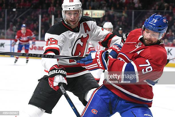 Andrei Markov of the Montreal Canadiens and Travis Zajac of the New Jersey Devils battle for position in the NHL game at the Bell Centre on November...