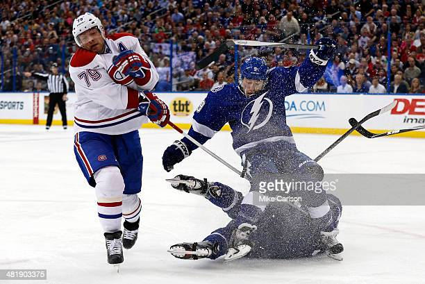 Andrei Markov of the Montreal Canadiens and Tyler Johnson of the Tampa Bay Lightning collide at the Tampa Bay Times Forum on April 1 2014 in Tampa...