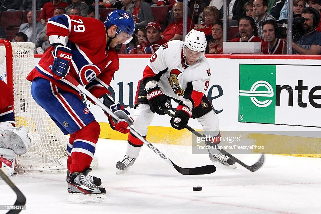 <a gi-track='captionPersonalityLinkClicked' href=/galleries/search?phrase=Andrei+Markov&family=editorial&specificpeople=204528 ng-click='$event.stopPropagation()'>Andrei Markov</a> #79 of the Montreal Canadiens battles for the puck against <a gi-track='captionPersonalityLinkClicked' href=/galleries/search?phrase=Milan+Michalek&family=editorial&specificpeople=544987 ng-click='$event.stopPropagation()'>Milan Michalek</a> #9 of the Ottawa Senators in Game Two of the Eastern Conference Quarterfinals during the 2013 NHL Stanley Cup Playoffs at the Bell Centre on May 3, 2013 in Montreal, Quebec, Canada.