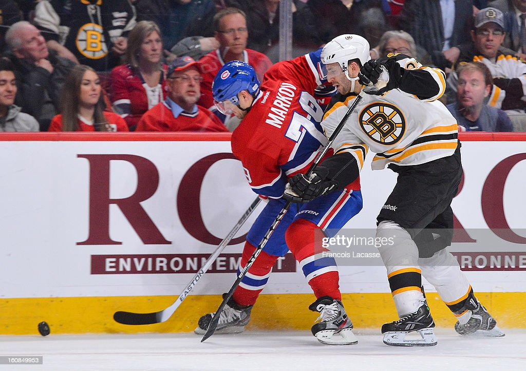 <a gi-track='captionPersonalityLinkClicked' href=/galleries/search?phrase=Andrei+Markov&family=editorial&specificpeople=204528 ng-click='$event.stopPropagation()'>Andrei Markov</a> #79 of the Montreal Canadiens battles for the puck with <a gi-track='captionPersonalityLinkClicked' href=/galleries/search?phrase=Patrice+Bergeron&family=editorial&specificpeople=204162 ng-click='$event.stopPropagation()'>Patrice Bergeron</a> #37 of the Boston Bruins during the NHL game on February 6, 2013 at the Bell Centre in Montreal, Quebec, Canada.