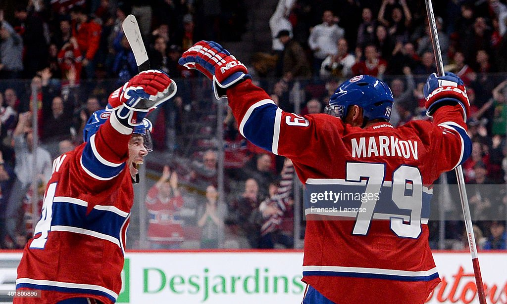 <a gi-track='captionPersonalityLinkClicked' href=/galleries/search?phrase=Andrei+Markov&family=editorial&specificpeople=204528 ng-click='$event.stopPropagation()'>Andrei Markov</a> #79 of the Montreal Canadiens, celebrates after scoring the winning goal against the Chicago Blackhawks during the NHL game on January 11, 2014 at the Bell Centre in Montreal, Quebec, Canada.