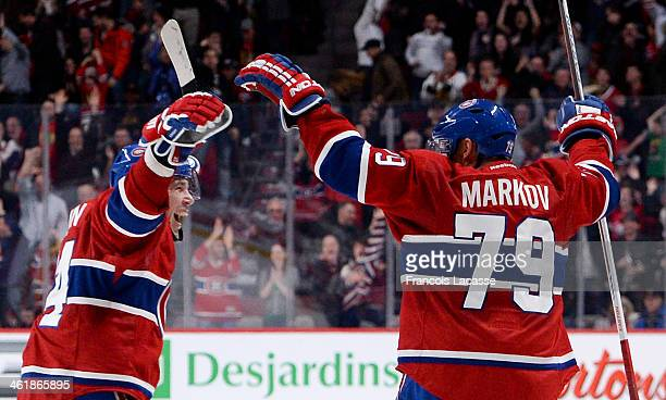 Andrei Markov of the Montreal Canadiens celebrates after scoring the winning goal against the Chicago Blackhawks during the NHL game on January 11...