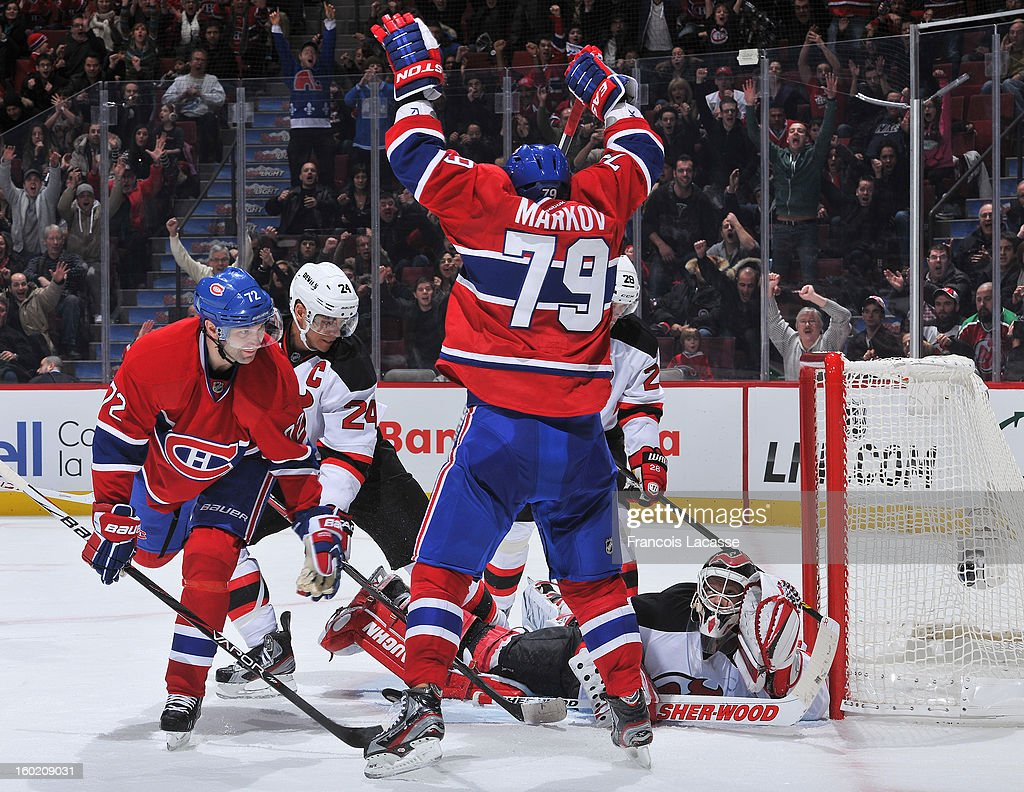 <a gi-track='captionPersonalityLinkClicked' href=/galleries/search?phrase=Andrei+Markov&family=editorial&specificpeople=204528 ng-click='$event.stopPropagation()'>Andrei Markov</a> #79 of the Montreal Canadiens celebrates his overtime winning goal against the New Jersey Devils as goalie <a gi-track='captionPersonalityLinkClicked' href=/galleries/search?phrase=Martin+Brodeur&family=editorial&specificpeople=201594 ng-click='$event.stopPropagation()'>Martin Brodeur</a> #30 and <a gi-track='captionPersonalityLinkClicked' href=/galleries/search?phrase=Erik+Cole&family=editorial&specificpeople=204754 ng-click='$event.stopPropagation()'>Erik Cole</a> #72 look on during the NHL game on January 27, 2013 at the Bell Centre in Montreal, Quebec, Canada.