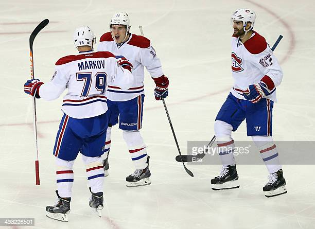 Andrei Markov of the Montreal Canadiens celebrates his second period goal with teammates Max Pacioretty and Brendan Gallagher against the New York...