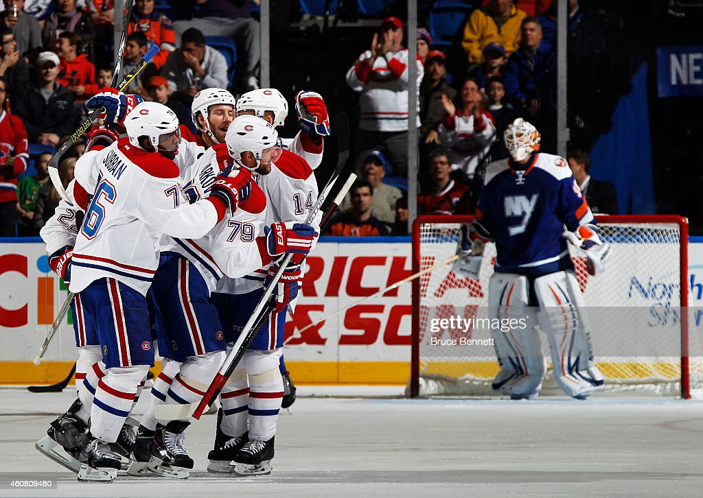 <a gi-track='captionPersonalityLinkClicked' href=/galleries/search?phrase=Andrei+Markov&family=editorial&specificpeople=204528 ng-click='$event.stopPropagation()'>Andrei Markov</a> #79 of the Montreal Canadiens celebrates with teammates after scoring a second period goal against the New York Islanders at Nassau Veterans Memorial Coliseum on December 23, 2014 in Uniondale, New York. This was Markov's 800th game.
