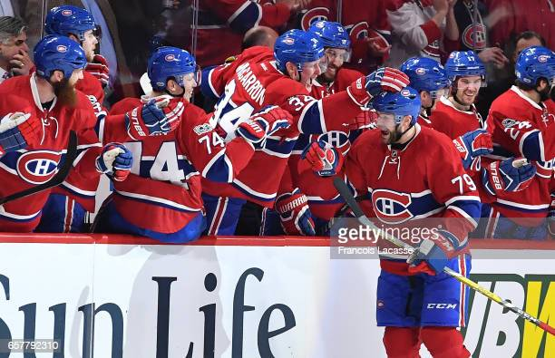 Andrei Markov of the Montreal Canadiens celebrates with the bench after scoring a goal against the Ottawa Senators in the NHL game at the Bell Centre...