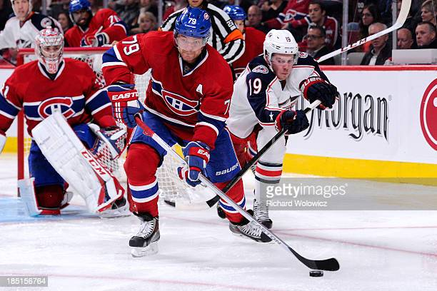 Andrei Markov of the Montreal Canadiens clears the puck in front of Ryan Johansen of the Columbus Blue Jackets during the NHL game at the Bell Centre...