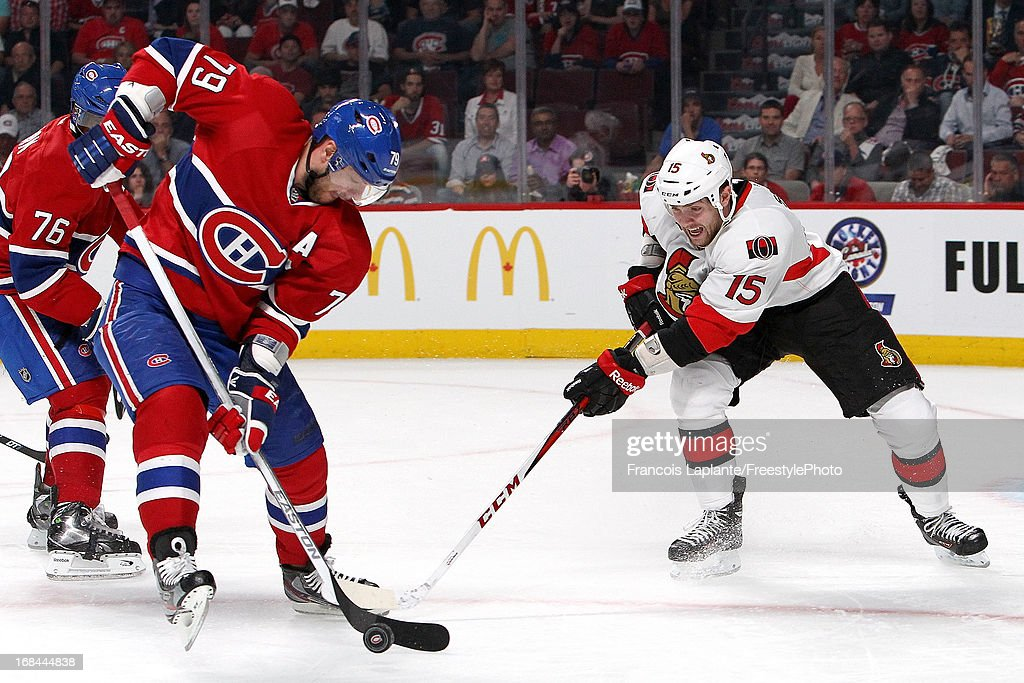 <a gi-track='captionPersonalityLinkClicked' href=/galleries/search?phrase=Andrei+Markov&family=editorial&specificpeople=204528 ng-click='$event.stopPropagation()'>Andrei Markov</a> #79 of the Montreal Canadiens controls the puck against Zack Smith #15 of the Ottawa Senators in Game Five of the Eastern Conference Quarterfinals during the 2013 NHL Stanley Cup Playoffs at the Bell Centre on May 9, 2013 in Montreal, Quebec, Canada.