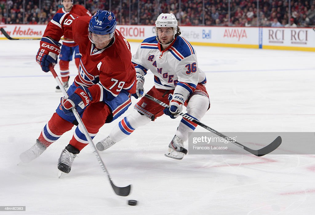 Andrei Markov #79 of the Montreal Canadiens controls the puck followed by Mats Zuccarello #36 of the New York Rangers during the NHL game on April 12, 2014 at the Bell Centre in Montreal, Quebec, Canada.