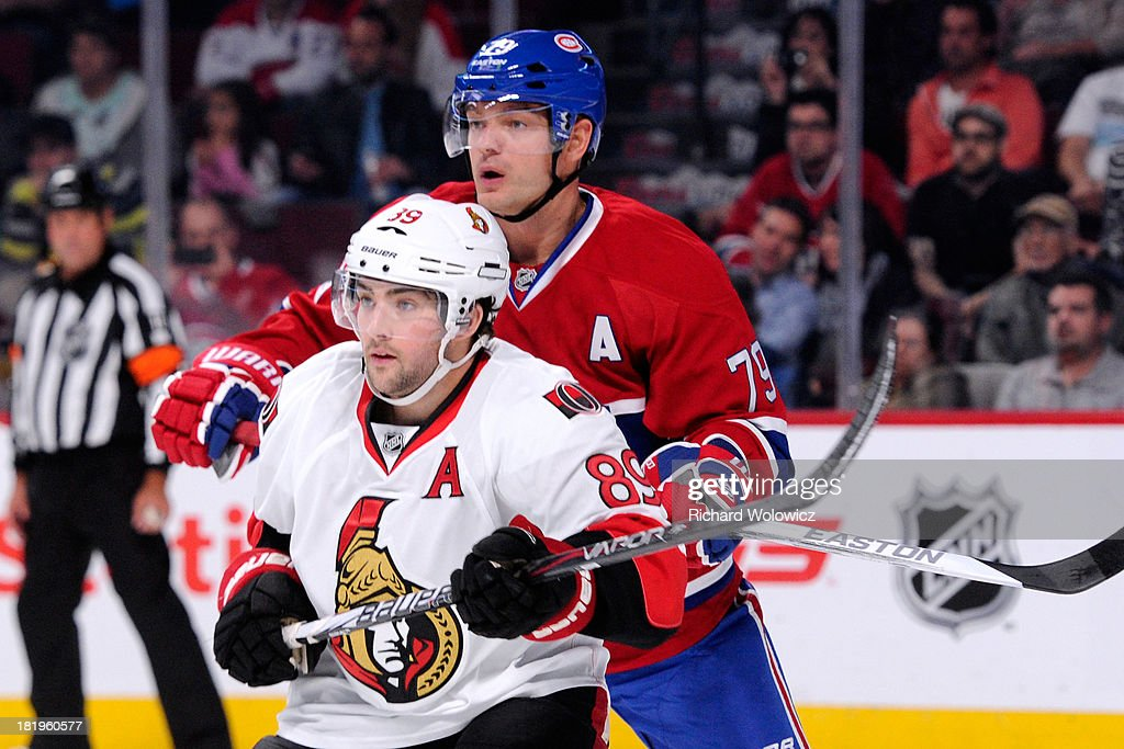 <a gi-track='captionPersonalityLinkClicked' href=/galleries/search?phrase=Andrei+Markov&family=editorial&specificpeople=204528 ng-click='$event.stopPropagation()'>Andrei Markov</a> #79 of the Montreal Canadiens defends against <a gi-track='captionPersonalityLinkClicked' href=/galleries/search?phrase=Cory+Conacher&family=editorial&specificpeople=8312407 ng-click='$event.stopPropagation()'>Cory Conacher</a> #89 of the Ottawa Senators during an NHL preseason game at the Bell Centre on September 26, 2013 in Montreal, Quebec, Canada.
