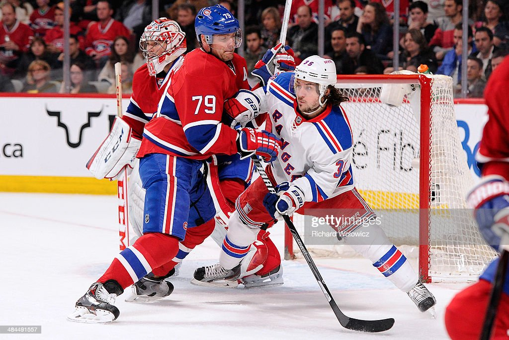 <a gi-track='captionPersonalityLinkClicked' href=/galleries/search?phrase=Andrei+Markov&family=editorial&specificpeople=204528 ng-click='$event.stopPropagation()'>Andrei Markov</a> #79 of the Montreal Canadiens defends against <a gi-track='captionPersonalityLinkClicked' href=/galleries/search?phrase=Mats+Zuccarello&family=editorial&specificpeople=7219903 ng-click='$event.stopPropagation()'>Mats Zuccarello</a> #36 of the New York Rangers during the NHL game at the Bell Centre on April 12, 2014 in Montreal, Quebec, Canada. The Canadiens defeated the Rangers 1-0 in overtime.