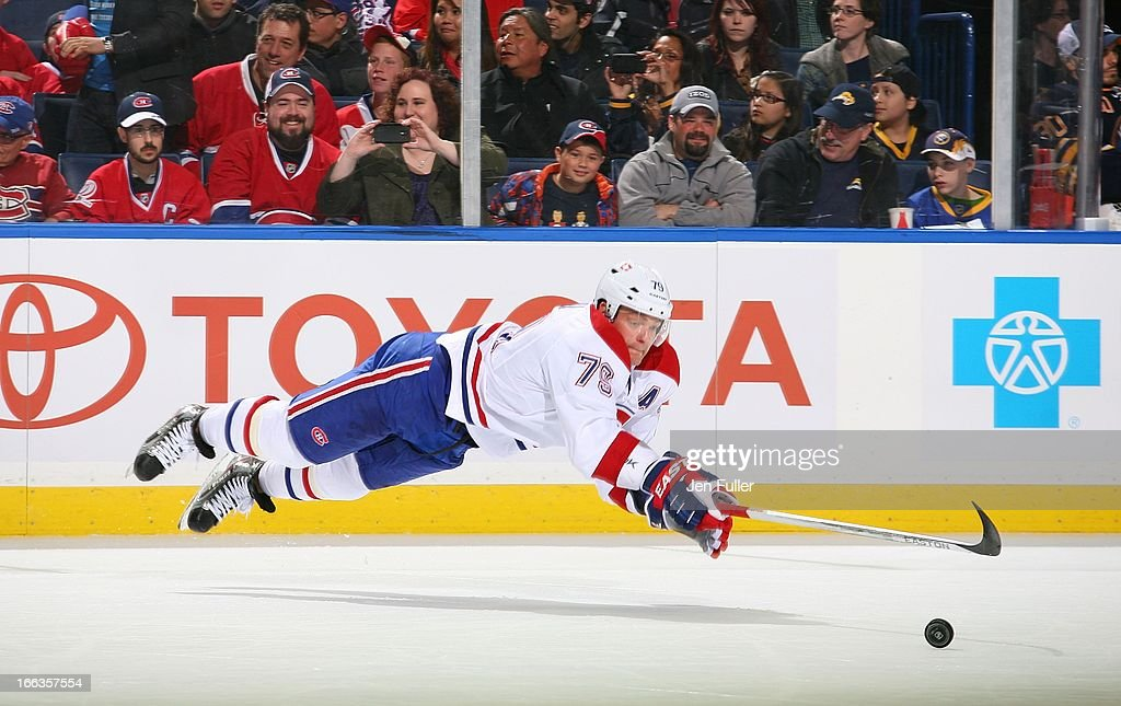 Andrei Markov #79 of the Montreal Canadiens dives to keep a puck in the zone against the Buffalo Sabres on April 11, 2013 at the First Niagara Center in Buffalo, New York. Montrel defeated Buffalo, 5-1.