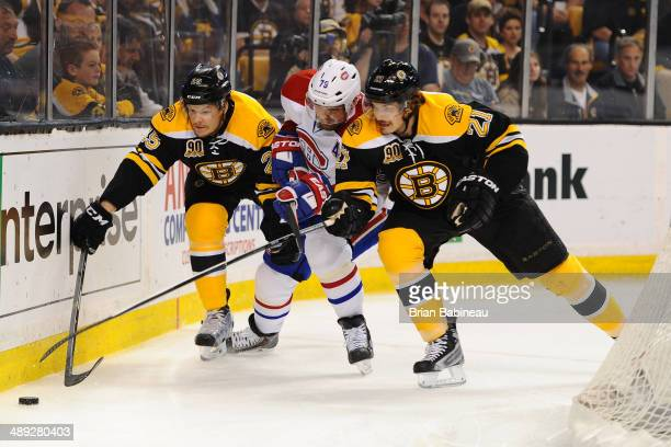 Andrei Markov of the Montreal Canadiens fights for the puck against Matt Fraser and Loui Eriksson of the Boston Bruins in Game Five of the Second...